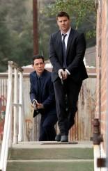 Booth (David Boreanaz) and Aubrey (John Boyd) approach the scene of a crime in BONES | © 2015 Jordin Althaus/FOX